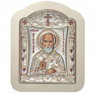 Посеребренная икона в светлой раме «Николай Чудотворец»